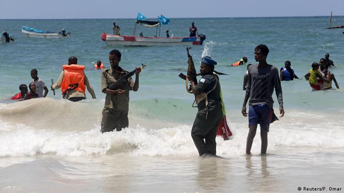 Police attempt to disperse swimmers on a Somalian beach (Reuters/F. Omar)