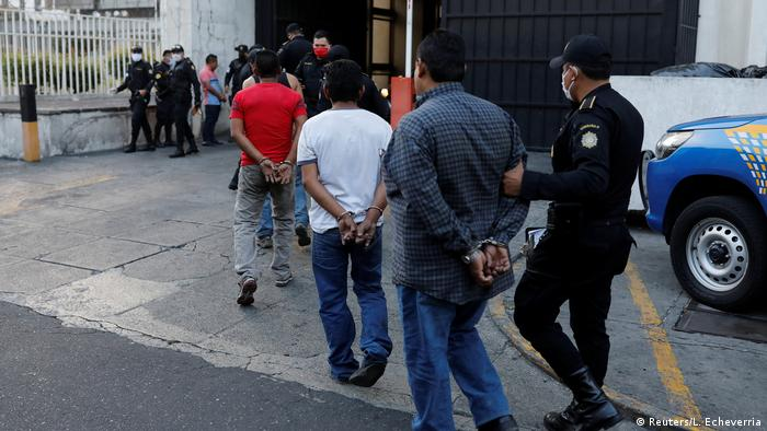 Guatamalan police escorting detained persons (Reuters/L. Echeverria)