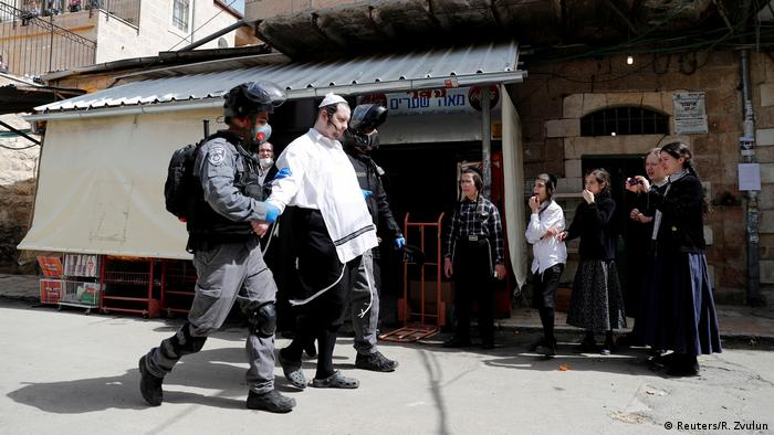 Police detaining an ultra-Orthodox man in Jerusalem, Israel (Reuters/R. Zvulun)