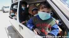 Mittlerer Osten Gaza Menschen mit Mundschutz