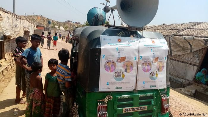 A rickshaw brings the information about the coronavirus to the people in the camp via loudspeaker
