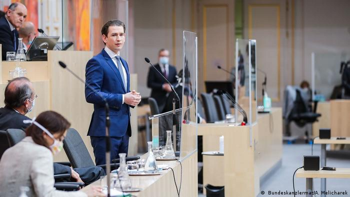The Austrian chancellor speaking at an emergency parliamentary session