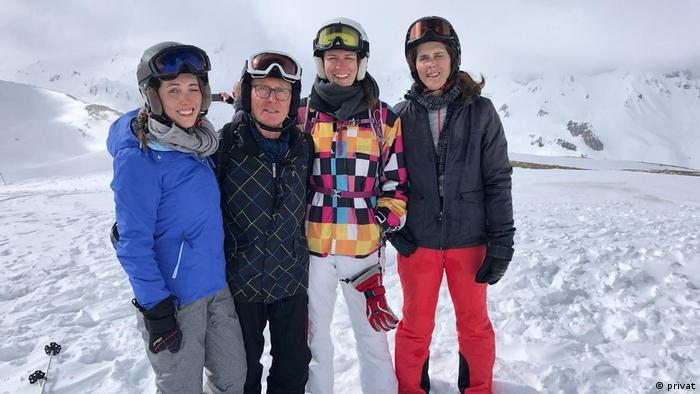 A German family posing for a picture from the Ischgl ski resort