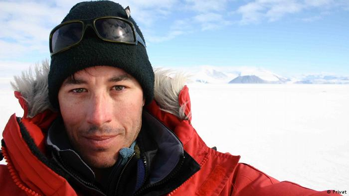 Senior scientist Jan Mankoff, of the Geological Survey of Denmark and Greenland, stands on top of an ice sheet in Greenland