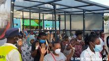People passing through a sanitizing chamber at the Kenya ferry crossing in Likoni, Mombasa DW, Faiz Musa Abdalla, 08.04.2020 in Mombasa, Kenia