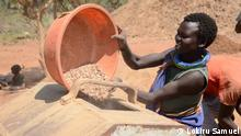 Exploiting minerals is a new way to earn a living in Karamoja, 27/2/2020, Uganda, Lokiru Samuel A young woman collects lime stone for the manufacturing of cement