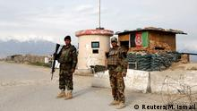 08.04.2020 *** Afghan National Army (ANA) soldiers stand guard at a checkpoint outside Bagram prison, north of Kabul, Afghanistan April 8, 2020. REUTERS/Mohammad Ismail