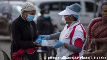 Südafrika Coronavirus Handschuhausgabe