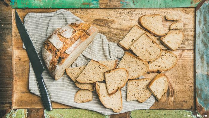 Bread and a knife on a cutting board