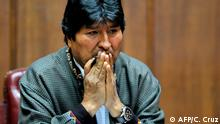 (FILES) In this file picture taken on November 27, 2019 Bolivia's exiled ex-President Evo Morales gestures as he delivers a speech at the Mexican Journalists Club, in Mexico City, on November 27, 2019. - Bolivia's attorney general's office ordered the arrest of exiled former president Evo Morales on December 18, 2019 following the interim government's accusation of sedition and terrorism. Morales fled Bolivia for Mexico last month and then to Argentina after civil unrest broke out following his controversial re-election in an October 20 poll widely denounced as rigged. (Photo by CLAUDIO CRUZ / AFP)