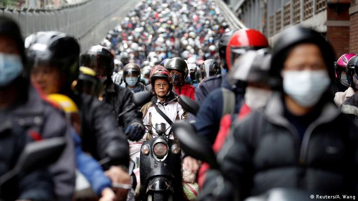 Commuters wear face masks to protect themselves from the coronavirus disease (COVID-19) spread during morning rush hour traffic in Taipei, Taiwan April 8, 2020