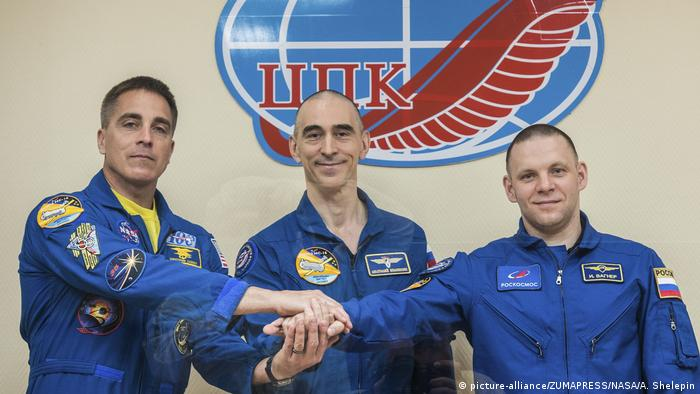Expedition 63 crew members Russians Ivan Vagner, right, Anatoly Ivanishin, center, of Roscosmos and American Chris Cassidy of NASA, pose while under quarantine inside the Cosmonaut Hotel at the Baikonur Cosmodrome