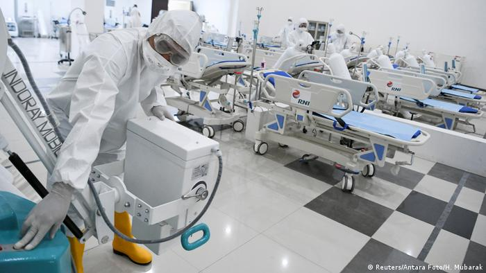 A medical officer checks devices at an emergency hospital, handling coronavirus in Indonesia (Reuters/Antara Foto/H. Mubarak)