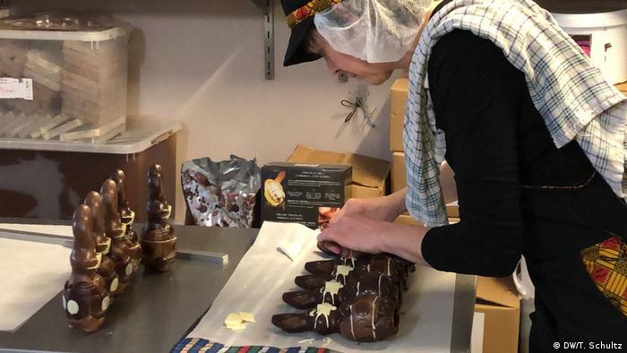 Belgian chocolatier Genevieve Trepant adds masks to Easter bunnies.