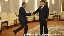 Tedros Adhanom, director general of the World Health Organization, left, shakes hands with Chinese President Xi Jinping before a meeting at the Great Hall of the People in Beijing, Tuesday, Jan. 28, 2020. (Naohiko Hatta/Pool Photo via AP) |