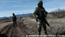 11.01.2020 FILE - In this Jan. 11, 2020 file photo, National Guard soldiers stand guard near Bavispe, Sonora state, Mexico, where family members of the extended LeBaron family were ambushed by gunmen last year, one day before the expected arrival of Mexican President Andrés Manuel López Obrador. The three women and six of their children, all U.S. citizens, were slaughtered and their cars burned here on Nov. 4, 2019. (AP Photo/Christian Chavez, File) |