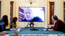 FILE PHOTO: Britain's Prime Minister Boris Johnson appears on a monitor for the coronavirus disease (COVID-19) meeting in London, Britain March 28, 2020. The prime minister chairs the morning update meeting on the coronavirus remotely from Number 11 Downing Street, since self-isolating after testing positive for the virus. To match Special Report HEALTH-CORONAVIRUS/BRITAIN-PATH Andrew Parsons/10 Downing Street/Handout via REUTERS ATTENTION EDITORS - THIS IMAGE HAS BEEN SUPPLIED BY A THIRD PARTY. IMAGE CAN NOT BE USED FOR ADVERTISING OR COMMERCIAL USE. IMAGE CAN NOT BE ALTERED IN ANY FORM. NO RESALES. NO ARCHIVES./File Photo