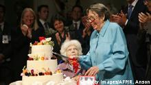 Lesbian rights pioneers Del Martin (C) and Phyllis Lyon (2ndR) cut their wedding cake after getting married at city hall in San Francisco, CA, on June 16, 2008. The couple wore the same pastel-colored pantsuits they donned four years ago when they wed the first time. Martin and Lyon were among the first of thousands of same-sex couples who plan to wed after the California Supreme Court granted lesbian and gay couples the constitutional right to marry. AFP PHOTO / Ryan ANSON (Photo credit should read Ryan Anson/AFP via Getty Images)