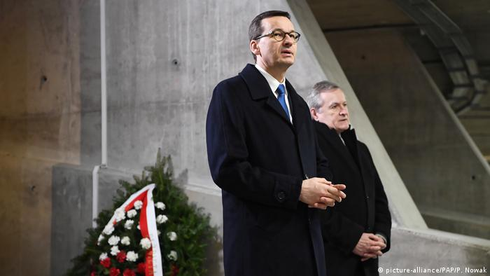 Prime Minister Mateusz Morawiecki (L) and Deputy Prime Minister Piotr Glinski (R) while laying wreaths at the grave of former President Ryszard Kaczorowski in the Temple of Divine Providence