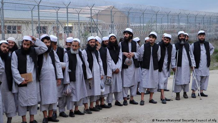 Newly freed Taliban prisoners line up at Bagram prison, north of Kabul, Afghanistan April 11, 2020