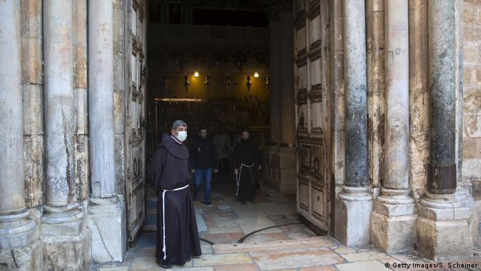A clergyman waits at the Church of the Holy Sepulchre (Getty Images/S. Scheiner)