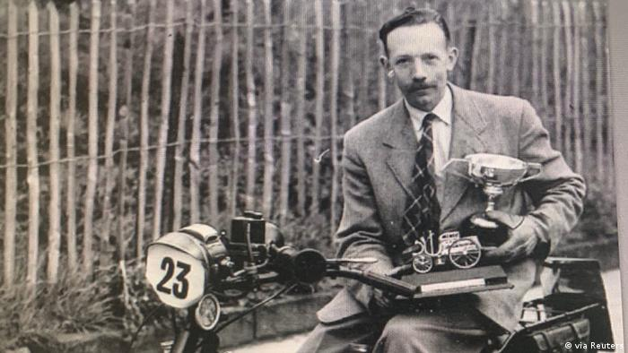 British Army Captain Tom Moore poses with trophies on a motorcycle (via Reuters)