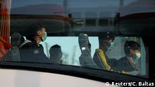 A group of unaccompanied children from overcrowded migrant camps who will be transferred to Germany and Luxembourg, wear protective face masks as a precaution against the spread of coronavirus disease (COVID-19) as they board a bus at the port of Piraeus, Greece, April 15, 2020. REUTERS/Costas Baltas
