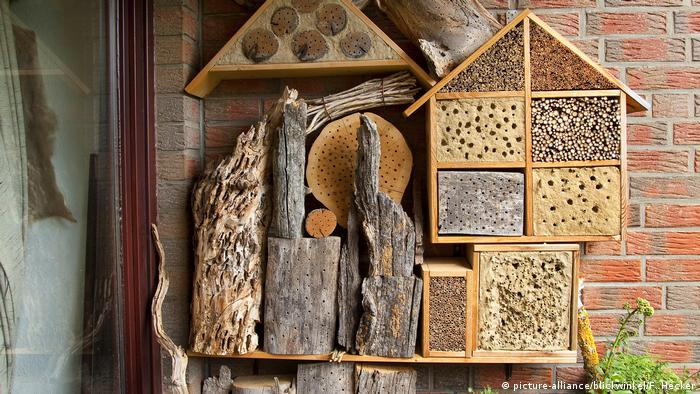 An insect hotel outside a house