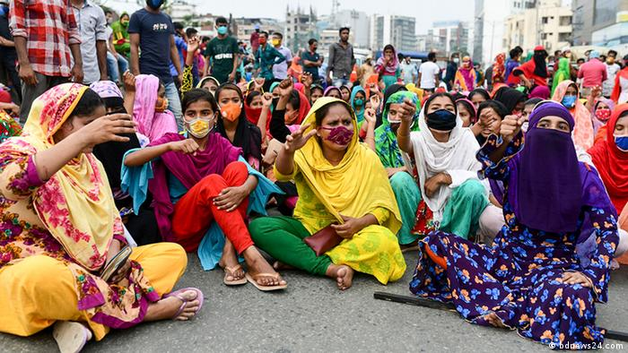 Unemployed Bangladeshi garment workers staging a sit-in in the streets of Dhaka