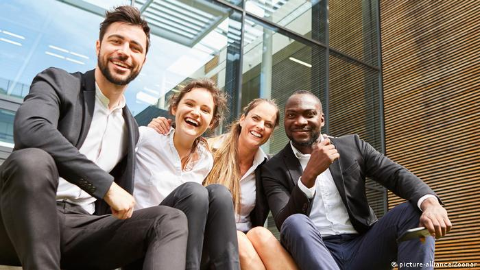 Diverse business team laughing