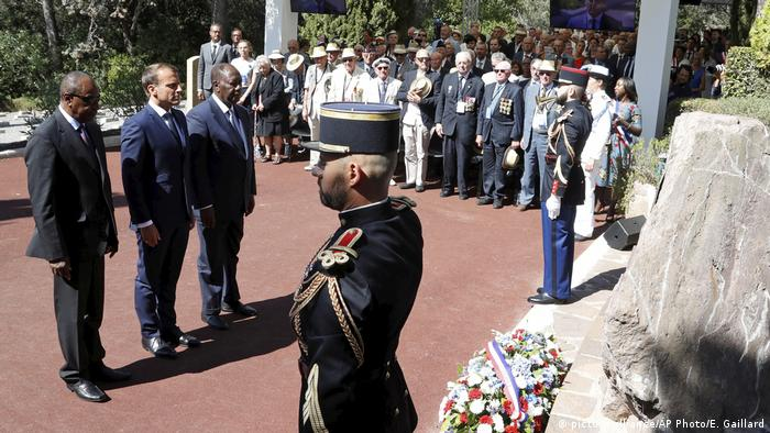 French President Emmanuel Marcon, Guinean President Alpha Conde (left) and Ivory Coast President Alassane Ouattara (right) remember fallen soldiers at a 2019 ceremony in Provence marking WWII