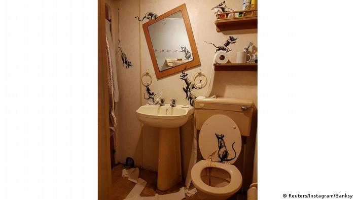 A Banksy artwork depicting rats in a bathroom