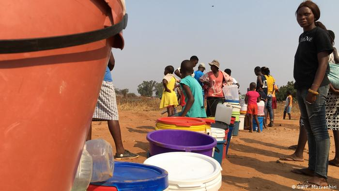 People queue for water in Zimbabwe.