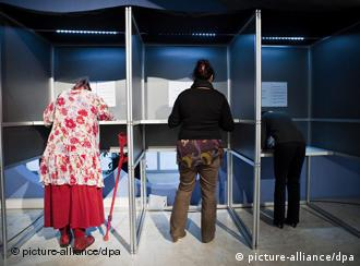People voting in voting booths