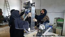 In this photograph taken on April 8, 2020, workers of an all-female robotic team build a ventilator in preparation for COVID-19 coronavirus patients, at a workshop, in Herat. - A team of robot-designing girls in Afghanistan is trying to build a low-cost medical ventilator from car parts, as health authorities look to boost critical-care capabilities for coronavirus patients in the impoverished country. If the teenagers succeed and can get government approval for their prototype, they say it could be replicated for as little as $300, where normally ventilators sell for around $30,000. (Photo by Ahmad Idres Naderi / AFP) (Photo by AHMAD IDRES NADERI/AFP via Getty Images)