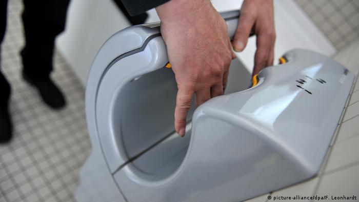 A man using a hand dryer