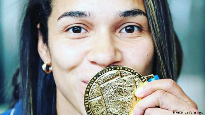 Colombian women's footballer Orianica Velasquez poses for a photo with her gold medal from the 2019 Pan American Games. (Orianica Velasquez)