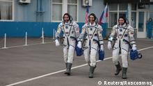 The International Space Station (ISS) crew members Chris Cassidy of NASA, Anatoly Ivanishin and Ivan Vagner of the Russian space agency Roscosmos walk before leaving to board the Soyuz MS-16 spacecraft at the Baikonur Cosmodrome, Kazakhstan April 9, 2020. Russian space agency Roscosmos/Handout via REUTERS ATTENTION EDITORS - THIS IMAGE HAS BEEN SUPPLIED BY A THIRD PARTY. MANDATORY CREDIT.
