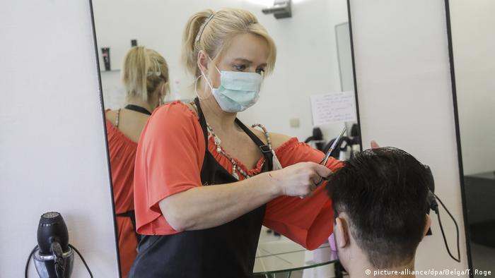 Hairdresser wearing a mask
