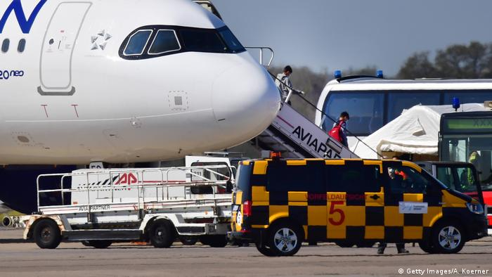 Refugees disembark an Aegean Air A320 with refugee children from Greece at Hanover Airport