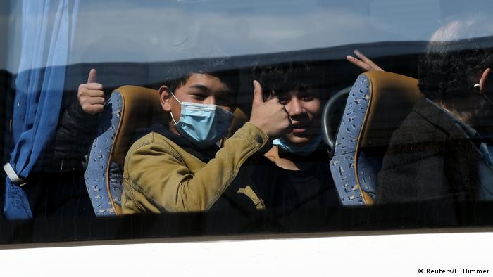 Unaccompanied children from overcrowded migrant camps in Greece gesture as they ride a bus after their arrival at the airport in Hanover (Reuters/F. Bimmer)