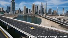 A lone taxi cab drives over a typically gridlocked highway with the Burj Khalifa, the world's tallest building, in the skyline behind it in Dubai, United Arab Emirates, Monday, April 6, 2020. Dubai, one of seven sheikdoms in the United Arab Emirates, is now under a 24-hour lockdown over the new coronavirus pandemic. (AP Photo/Jon Gambrell) |