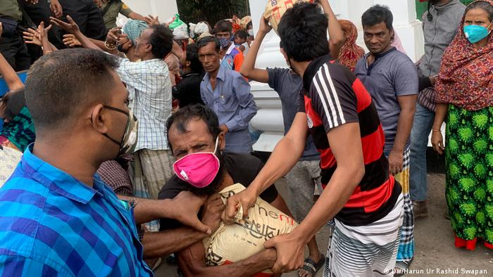 Helpers distributing aid to people in Dhaka