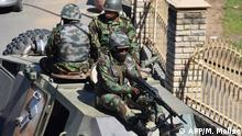 Lesotho Defense Force patrols the town of Maseru on April 18, 2020. - Lesotho's embattled prime minister Tom Thabane announced on Saturday he had sent troops onto the streets to restore order, accusing unnamed law enforcement agencies of undermining democracy. (Photo by Molise MOLISE / AFP)