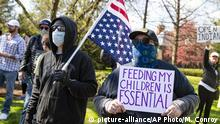 Protesters gather outside the Indiana governor's mansion in Indianapolis, Saturday, April 18, 2020, to protest against the governor's stay-at-home order to ease restrictions meant to control the spread of the coronavirus. (AP Photo/Michael Conroy) |