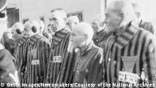 377234 17: FILE PHOTO: Prisoners stand in lines outdoors in the concentration camp at Sachsenhausen, Germany, December 19, 1938. (Courtesy of the National Archives/Newsmakers)