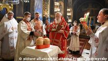 Patriarch Filaret of the Ukrainian Orthodox Church, center, conducts an Easter service with some of the priests wearing face masks to help protect themselves against the coronavirus at the Volodymysky Cathedral in Kyiv, Ukraine, Sunday, April,19, 2020. All the Ukrainian churches have been closed for people because of COVID-19 outbreak. Easter - by far the most significant religious holiday for the world's roughly 300 million Orthodox - has essentially been cancelled. (AP Photo/Volodymyrsky Cathedral Press Service via AP)