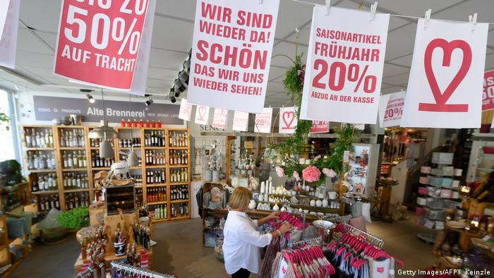 A lifestyle store in Ludwigsburg, Saxony-Anhalt, welcomes customers again after the coronavirus lockdown in Germany with a banner and discounts.