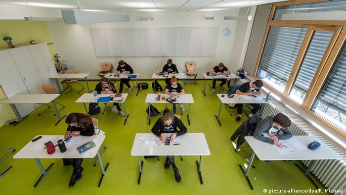 A school in Dresden, Saxony, is allowing older pupils back into classrooms so they can prepare for their school-leavers exams. Schools in Saxony, Brandenburg and Berlin are allowed to reopen if they abide by social distancing measures to help stop the spread of the coronavirus.