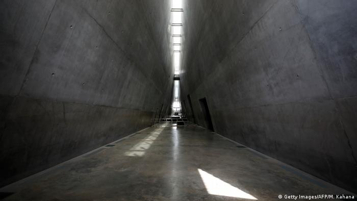 Yad Vashem's prism-like triangular structure with a 200-meter-long glass skyligh
